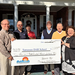 Tamassee DAR School receiving donation from Keowee Key Boating association fund raiser